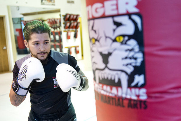 Tiger Schulmann's Martial Arts | Man On Boxing Gloves