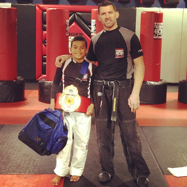 Tiger Schulmann's Martial Arts | Man And Kid With Championship Belt