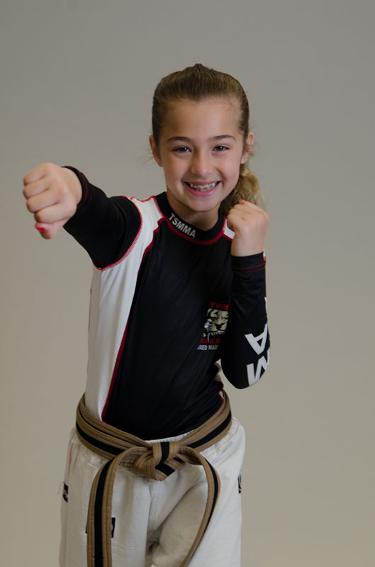 Tiger Schulmann's Martial Arts | Girl Punching Pose