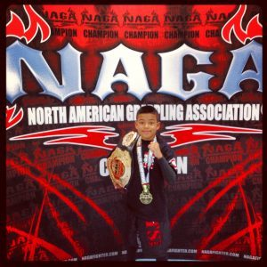 Tiger Schulmann's Martial Arts | Boy with Medala and Championship Belt