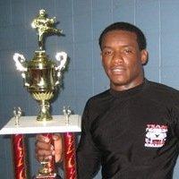 Tiger Schulmann's Martial Arts | Man With Trophy