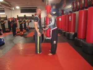 Tiger Schulmann's Martial Arts | Man Giving Black Belt