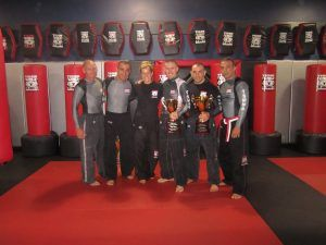 Tiger Schulmann's Martial Arts | Men Group Photo with Trophy