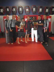 Tiger Schulmann's Martial Arts   Men Group Photo with Trophy