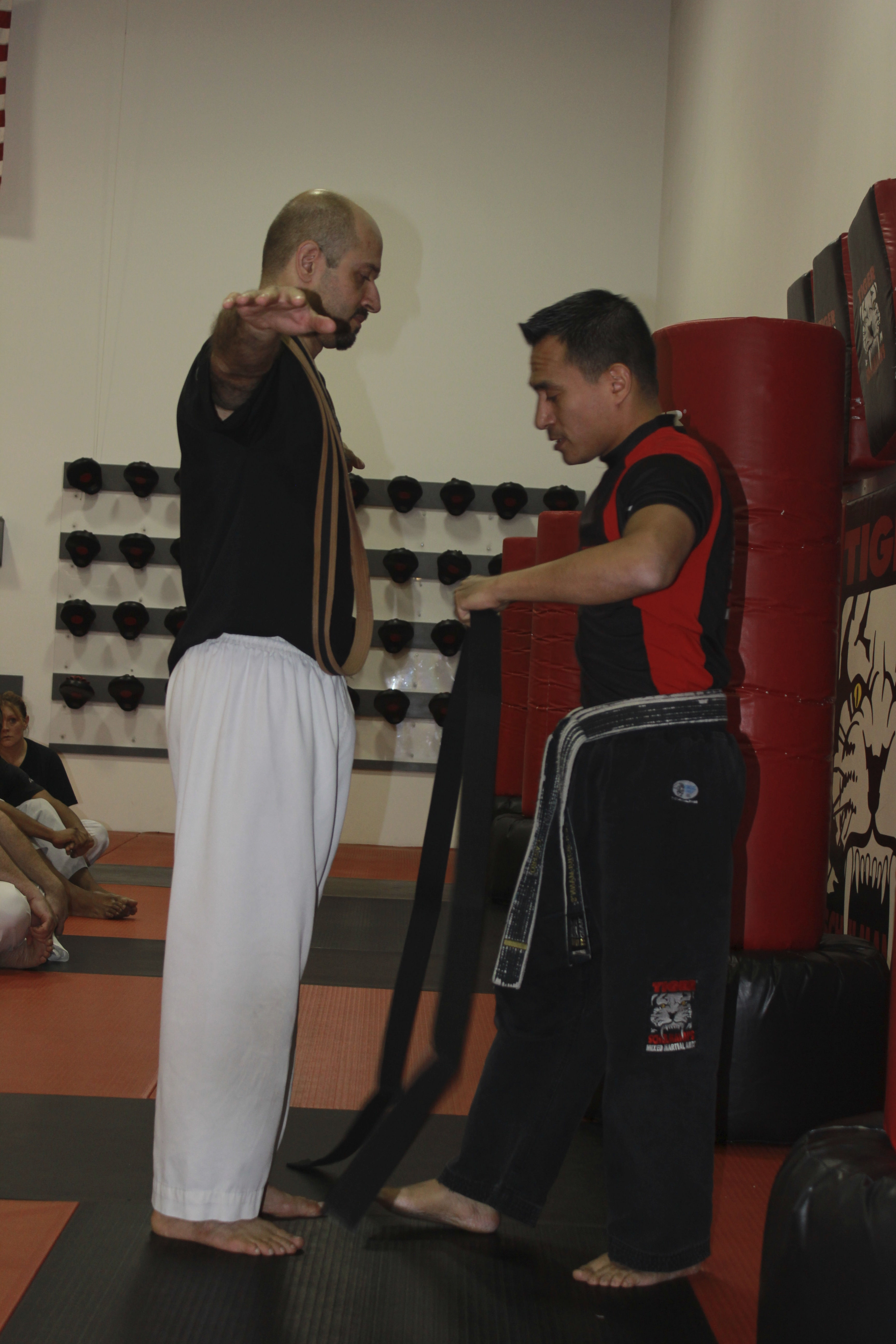 Tiger Schulmann's Martial Arts | Man Giving Belt