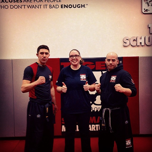 Tiger Schulmann's Martial Arts | Woman Thumbs Up Group Photo