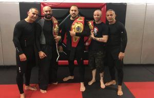 Tiger Schulmann's Martial Arts | Men with Championship Belts