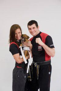 Tiger Schulmann's Martial Arts | Man and Woman with Puppy