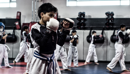 Tiger Schulmann's Martial Arts | Boy with White Gloves