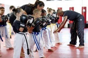 Tiger Schulmann's Martial Arts | Man Training Children