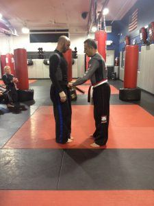 Tiger Schulmann's Martial Arts | Men Fixing Belt