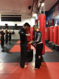 Tiger Schulmann's Martial Arts | Man Ties Belt To Another Man