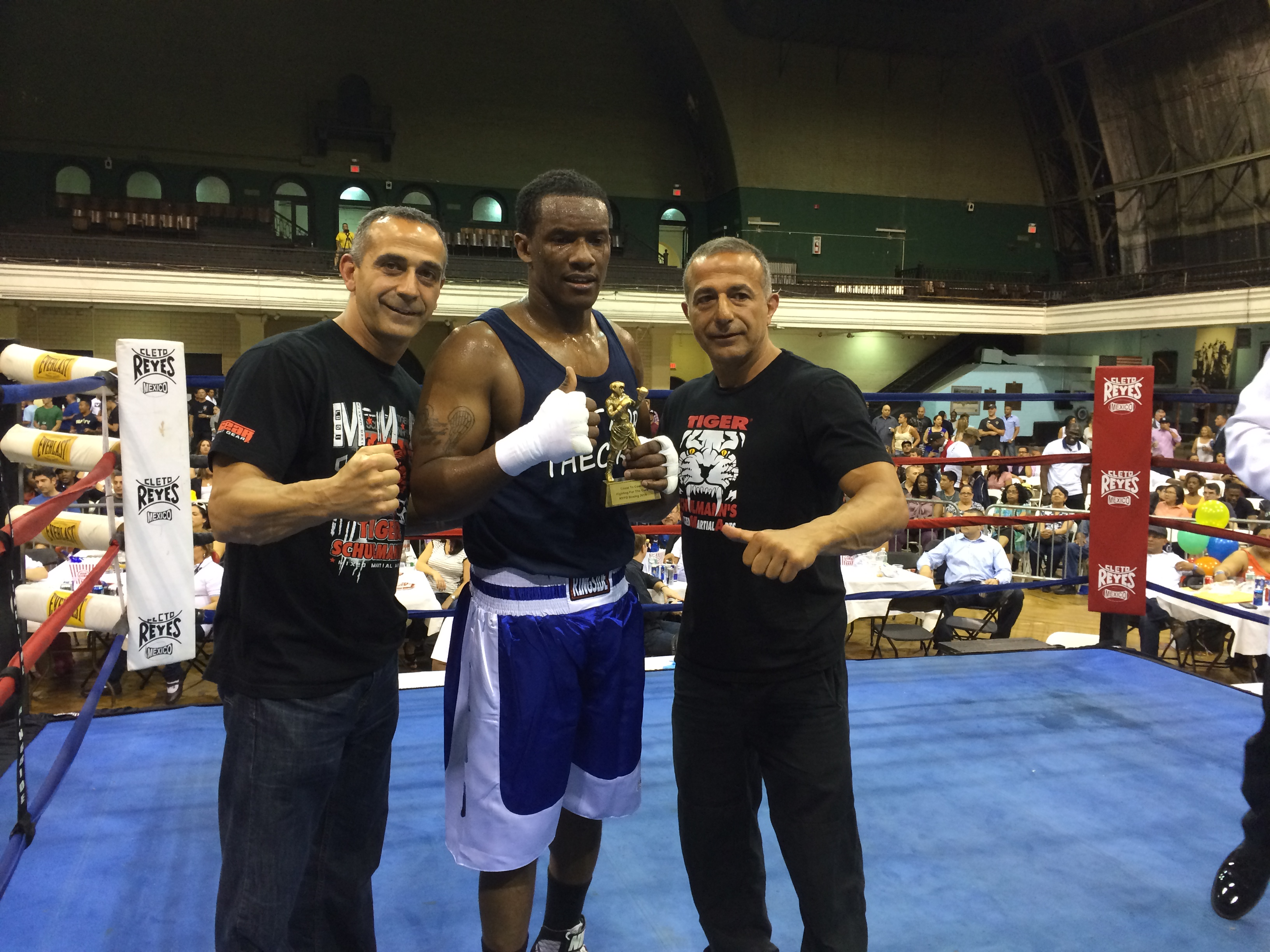 Tiger Schulmann's Martial Arts | Winner with Trophy on the Ring