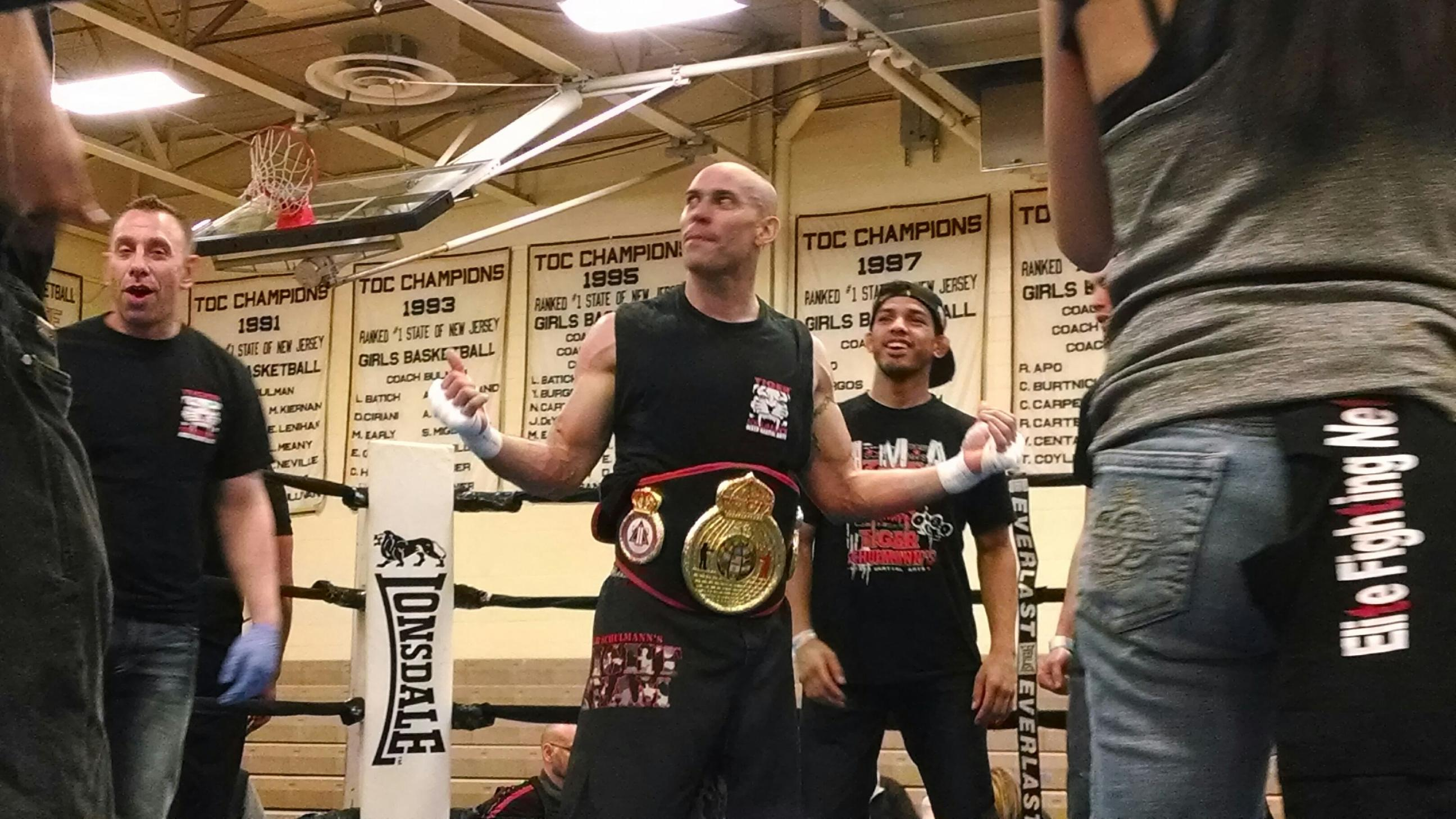 Tiger Schulmann's Martial Arts | Man with Championship Belt