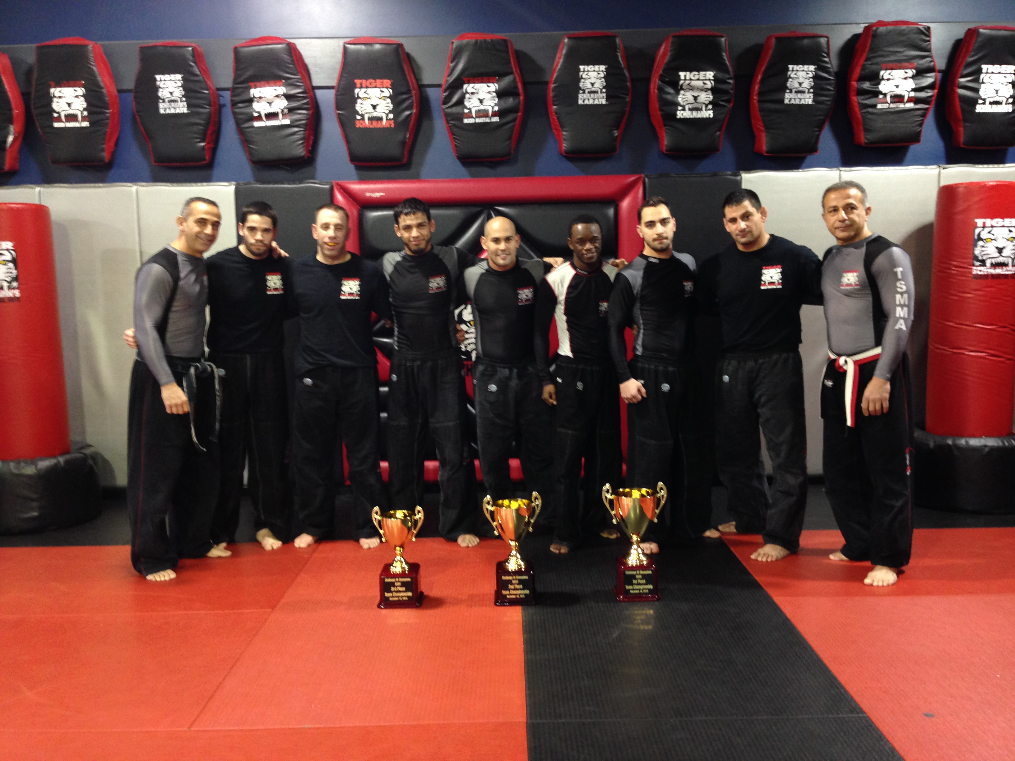 Tiger Schulmann's Martial Arts | Group Photo Of Men With Trophies