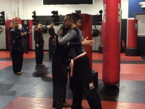 Tiger Schulmann's Martial Arts   Men Hugging