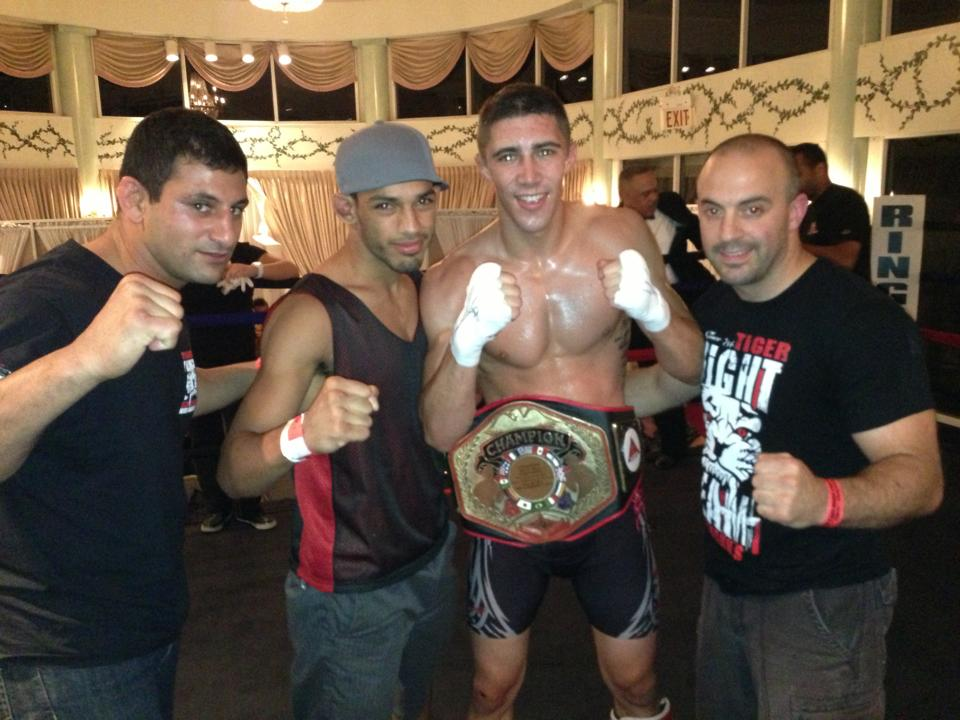 Tiger Schulmann's Martial Arts | Men Group Photo with Championship Belt
