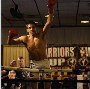 Tiger Schulmann's Martial Arts | Man Raising Hands