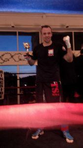 Tiger Schulmann's Martial Arts   Man with Trophy